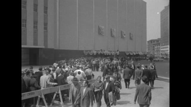 vídeos de stock, filmes e b-roll de pan down of the exterior of the coliseum with a long line of people below / ms the line of people at street level / ms gov averell harriman robert... - cortando fita