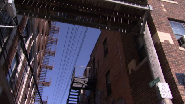 pan down onto an alleyway in rapid city, south dakota. - rapid city stock videos & royalty-free footage