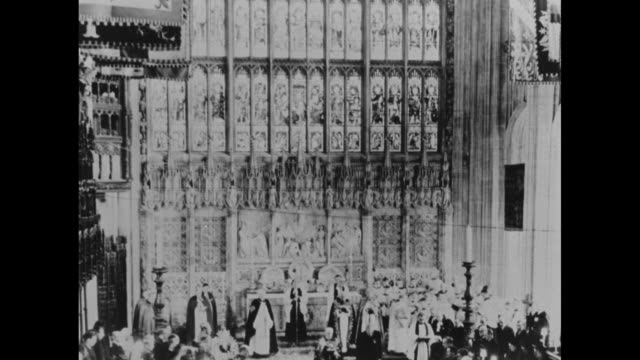 pan down still photo of stained glass windows in int st george's chapel during funeral of king george vi to women of the royal family during conduct... - 1952 bildbanksvideor och videomaterial från bakom kulisserna