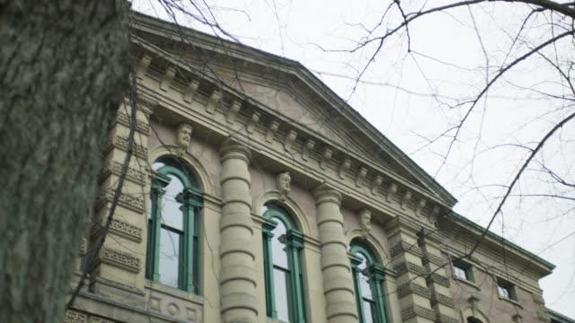 pan down superior court building. sign visible at entrance.