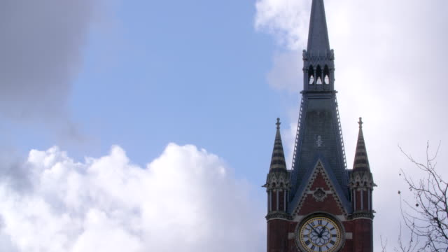 Pan down the clock tower of the St Pancras Hotel on London's Euston Road.