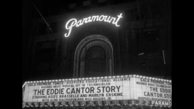 pan down the paramount theater marquee with the eddie cantor story starring keefe brasselle and marilyn erskine in bright lights / the rear of a... - musical theater stock videos and b-roll footage