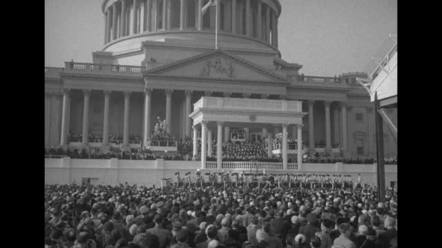 pan down us capitol dome, inaugural platform and crowd / repeat shot / house wing of capitol with inaugural crowd around it / inaugural crowd with... - us senat stock-videos und b-roll-filmmaterial