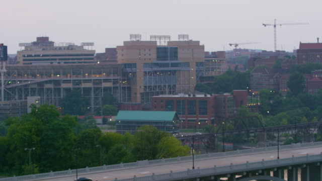 pan downward: buildings of knoxville (shot on red) - university of tennessee stock videos and b-roll footage