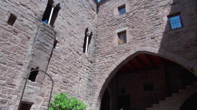 Pan Downward of the Walls of Cardona Spain Church