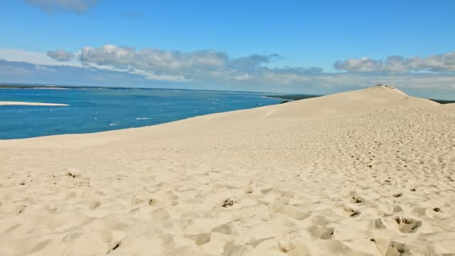 pan: dune de pilat, france, in summer - dune of pilat stock videos and b-roll footage