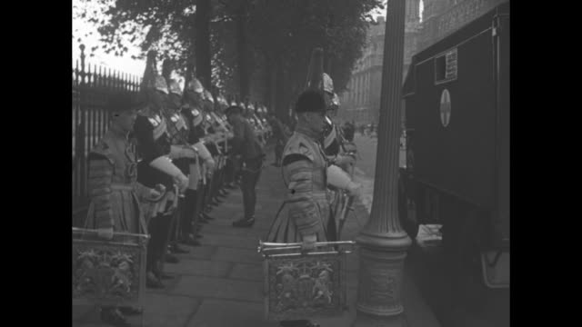 ws pan ext palace of westminster in london / ls line of blues and royals members and buglers on street officer is touching up some members' uniforms... - tassel stock videos & royalty-free footage
