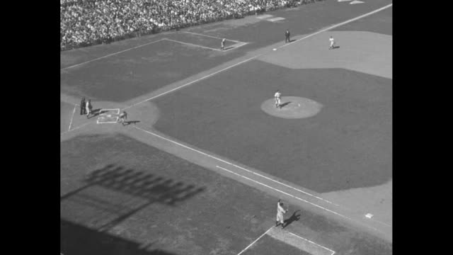 WS pan exterior of stadium with large 'Crosley Field' sign above banner that reads 'Baseball Centennial' / crowd makes its way into stadium / WS pan...