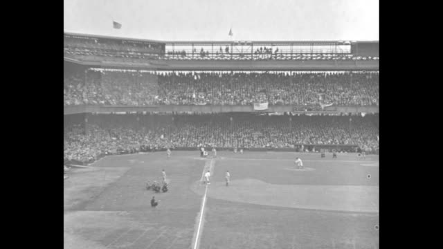 pan fans in stands and baseball game at griffith stadium in washington dc between the washington senators and boston red sox / pan fans in stands and... - 1934 stock videos & royalty-free footage