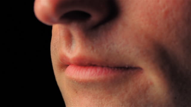 pan from man's mouth to nose - human mouth stock videos & royalty-free footage