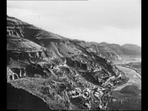 Pan from Qin Mountains in Shaanxi Province to river valley below / pan buildings in Yenan capital of Communist China / CU Chinese Communist leader...
