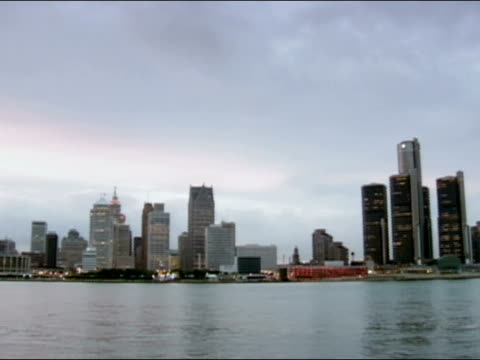 pan from right to left across detroit river of downtown detroit skyline / detroit, michigan - detroit river stock-videos und b-roll-filmmaterial