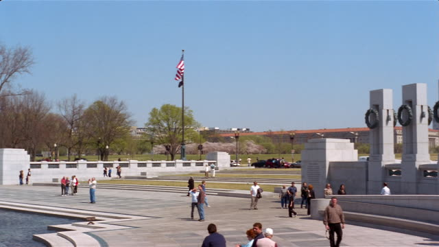 pan from right to left across pillars and fountain at national world war ii memorial  in washington, dc - war stock-videos und b-roll-filmmaterial