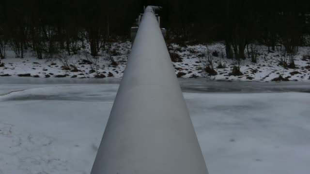 pan from snowcovered landscape to a section of the urengoypomaryuzhgorod pipeline also known as the westsiberian pipeline or the transsiberian... - {{relatedsearchurl('capsule pipeline')}} stock videos and b-roll footage