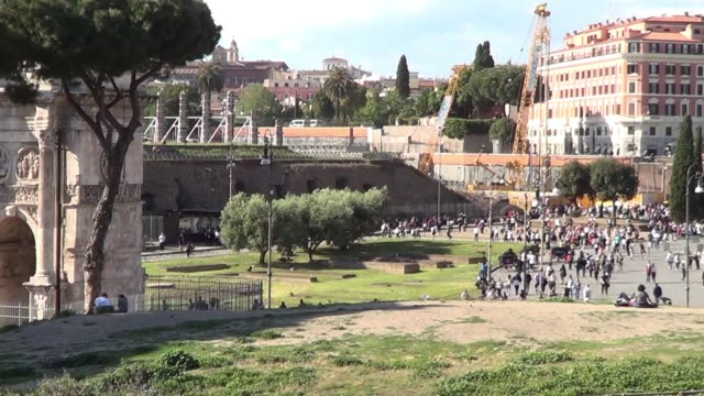 pan from the arch of constantine to the colosseum in rome italy from outside surrounded by tourists - arch of constantine stock videos and b-roll footage