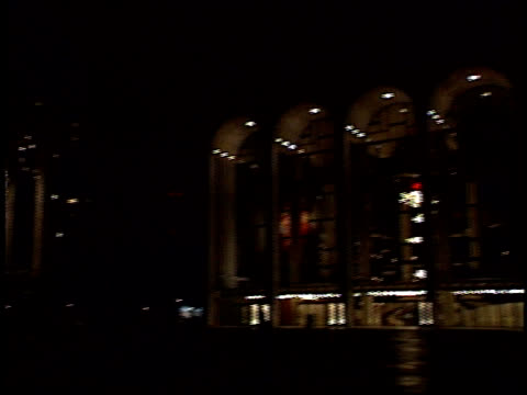 pan from The Lincoln Center lit up at night to surrounding buildings