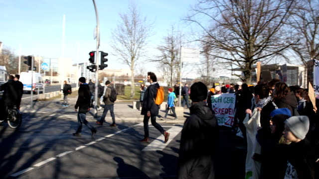 pan from the right to the left striking high school students march to protest for more effective government climate change policy on on february 15... - climate policy stock videos & royalty-free footage
