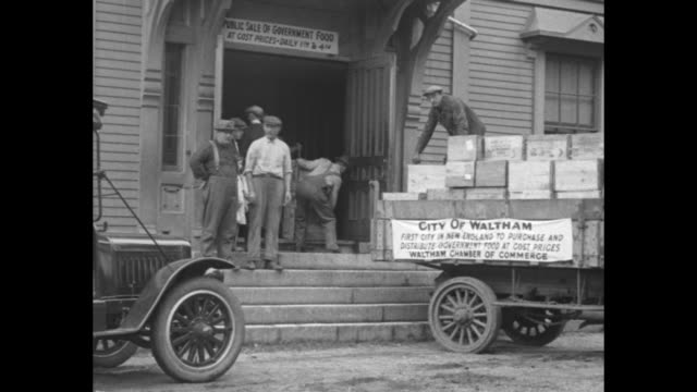 city of waltham first city in new england to purchase and distribute government food / a line of men women and children standing in line at open... - 1910 1919 stock videos and b-roll footage