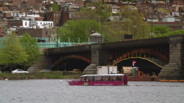 pan from water taxi to residential boston - water taxi stock videos & royalty-free footage