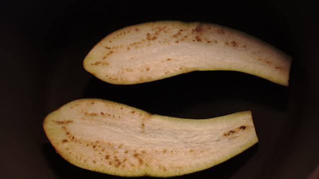 pan fry eggplants darken soften salt x40 speed - aubergine stock videos & royalty-free footage