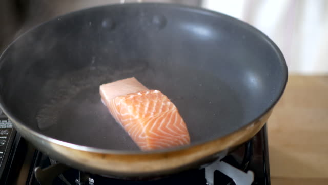pan fry salmon fillet - salmon stock videos & royalty-free footage