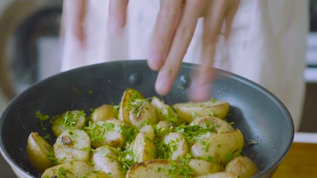pan frying baby potato - garnish stock videos & royalty-free footage