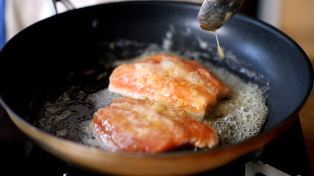 pan frying salmon fillet - butter stock videos and b-roll footage