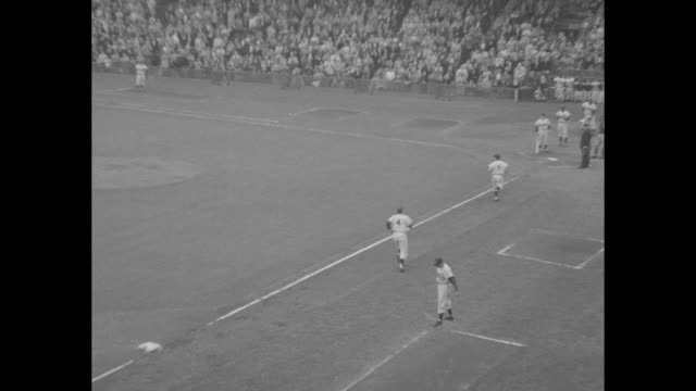 ws pan game and crowded stands at ebbets field as brooklyn dodgers play the pittsburgh pirates for the national league pennant / vs fans in stands /... - home run stock-videos und b-roll-filmmaterial