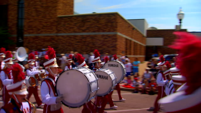 pan going with the marching band passing by - marching band stock videos & royalty-free footage
