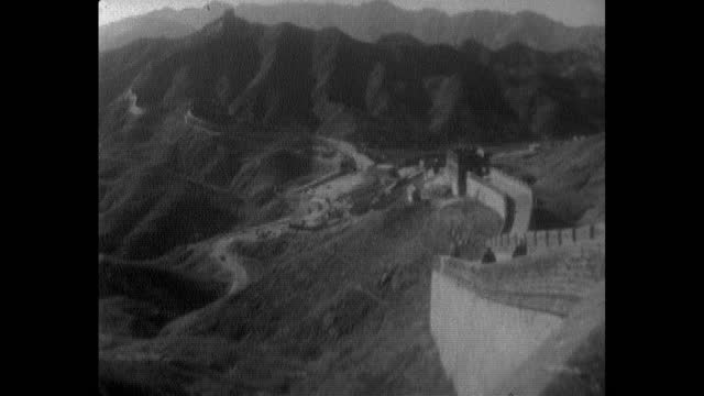 pan great wall of china and landscape; 1964 - surrounding wall stock-videos und b-roll-filmmaterial