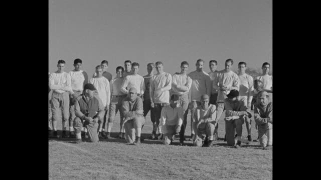 pan group shot football team stands in line on field / norman ok ms college football allamerican player waddy young stands on campus of university of... - sweatshirt stock videos and b-roll footage