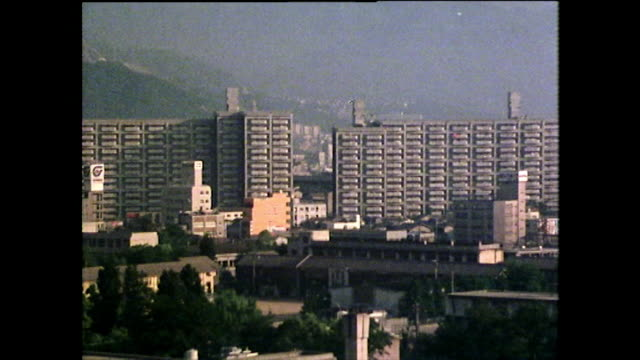 pan hiroshima cityscape with high speed, elevated train; 1975 - elevated train stock videos & royalty-free footage