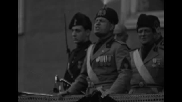 pan huge enthusiastic crowd and gathering of blackshirts / benito mussolini gesturing with arm while speaking from reviewing stand filled with... - benito mussolini stock videos & royalty-free footage