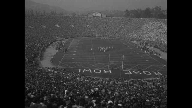 ws pan int rose bowl stadium in pasadena ca with packed stands as the michigan state spartans play the ucla bruins / ws stadium from pov upper level... - anno 1954 video stock e b–roll
