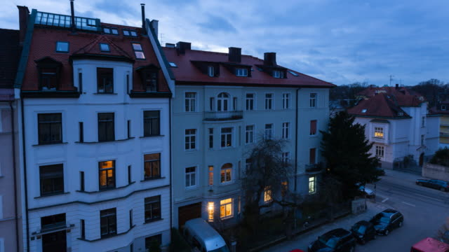 tl pan l, aerial view of residential street with apartments - fenster stock-videos und b-roll-filmmaterial
