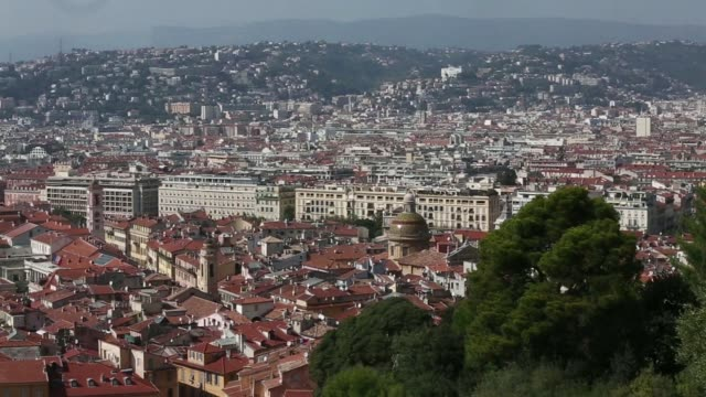 Pan L R from Mediterranean Sea to beach property rooftops on the city skyline in Nice France on Friday Sept 26 A domed building stands on the skyline...