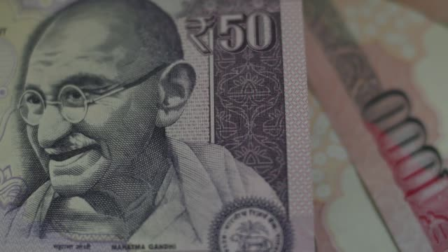 pan cs l r indian fifty rupee banknote cs pull focus into indian fifty rupee banknote mcs pull focus into a stack of indian fifty rupee banknotes on... - financial accessory stock videos & royalty-free footage
