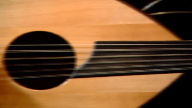 pan left across a shortneck pearshaped stringed instrument known as an oud being plucked - stringed instrument stock videos & royalty-free footage