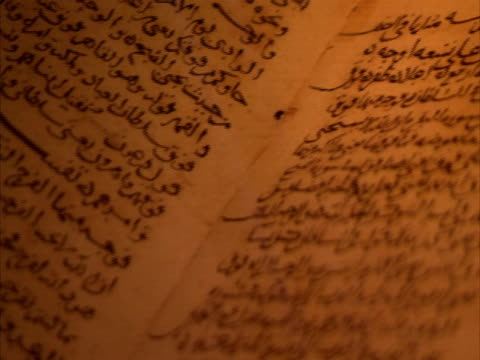 Pan left across Arabic manuscripts, Egypt (sound available)