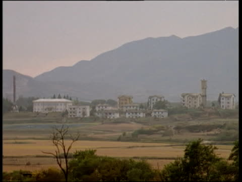 Pan left across deserted village along North Korean border