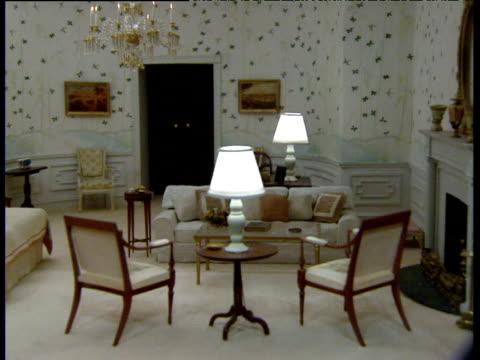pan left across dolls' house version of white house president's bedroom - おもちゃの家点の映像素材/bロール