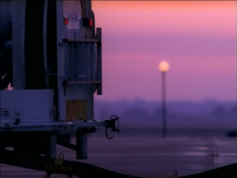 pan left across fuel line as aviation workers refuel aircraft - refuelling stock videos & royalty-free footage