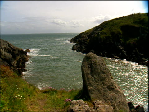 pan left across rocky cove pembrokeshire - pembrokeshire stock videos & royalty-free footage
