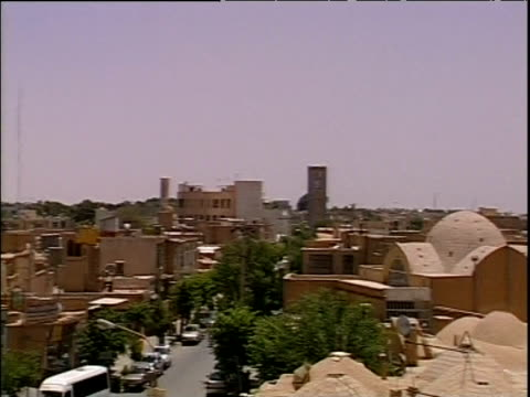 pan left across rooftops to blue dome of mosque yazd iran - yazd province stock videos & royalty-free footage