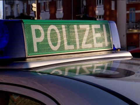 pan left across row of parked german police cars hamburg - polizeiauto stock-videos und b-roll-filmmaterial
