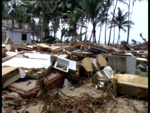 Pan left across rubble of house destroyed by tsunami Sri Lanka 4 Jan 05