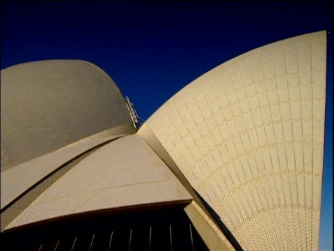 pan left across shell structure of sydney opera house - bennelong point stock videos and b-roll footage