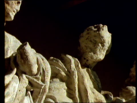 stockvideo's en b-roll-footage met pan left across statues of the apostles, their faces eroded by acid rain, krakow, poland - apostel