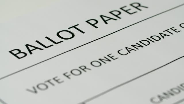 pan left across white ballot paper - politics stock videos & royalty-free footage