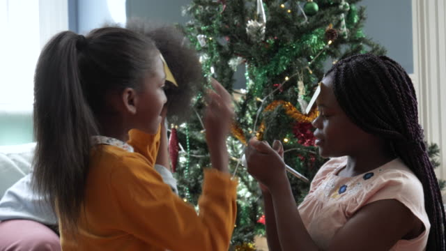 pan left, african american family play game on christmas - christmas decoration stock videos & royalty-free footage